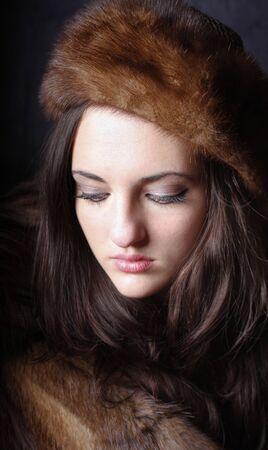 russian hat: beautiful young girl wearing fur hat Stock Photo