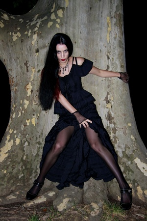 sexy gothic girl alone in the dark