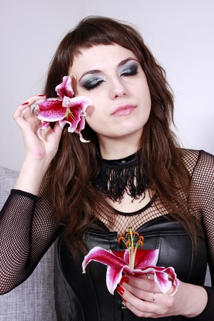 Gothic girl with flowers Stock Photo
