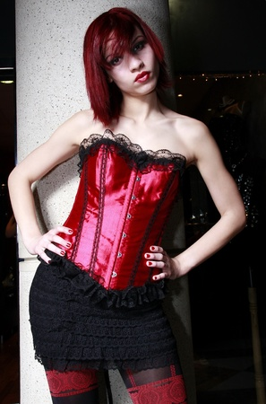 red corset: Beautiful redhead model wearing a red corset
