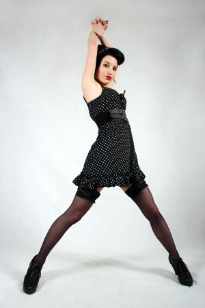 Pin up girl all in black with nice stockings
