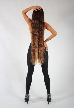 Beautiful young slim model with long legs and hair