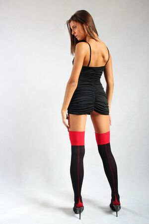 Beautiful young slim model with long legs in stockings