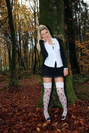 Model in woods in white stockings Stock Photo
