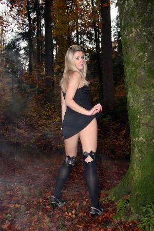 Model in woods in black stockings Stock Photo