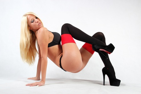 Blond Playboy model in black and red stockings