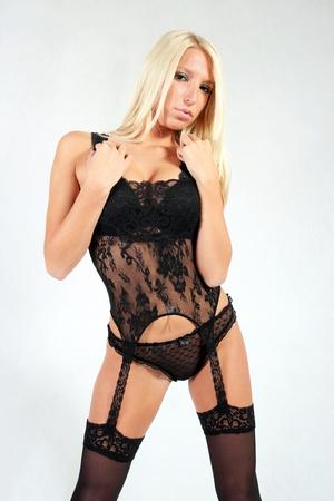 Blond Playboy model in body stockings Stock Photo