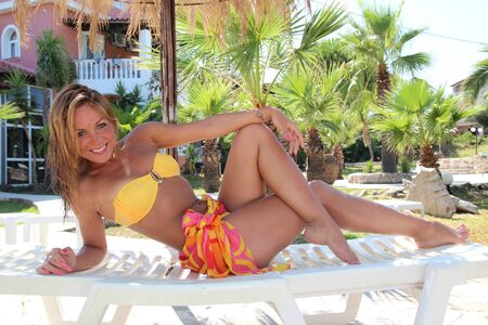 Young beautiful woman outdoors on the sunbed Stock Photo
