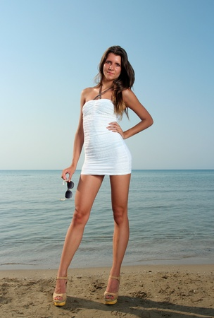 Girl at the beach in sexy dress