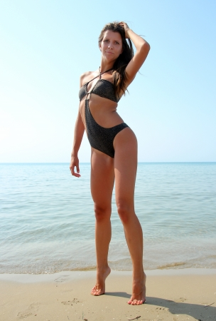 Girl at the beach in black bikini photo