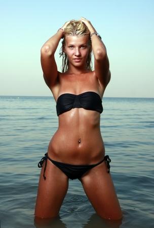 Girl at the beach in bikini at twilight Stock Photo