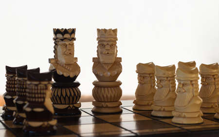 chess black and white king with pawns on the playing board