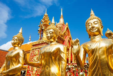 mai: gold statues of Buddha in a temple Doi Suthep in Chiang Mai. Thailand. Editorial
