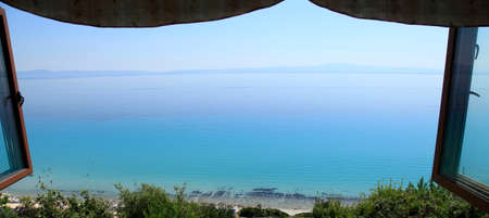 Open window looking out on the sea and beach, at Halkidiki, Greece photo