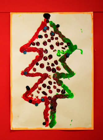 actual: Photo of an actual christmas tree prepared and painted by a child on the wall