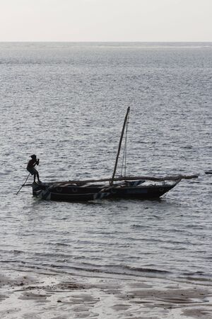 punting: Traditional Kenyan sail boat with fisherman punting