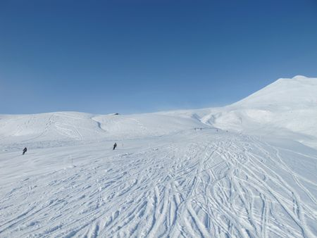 Skiers on wide open piste in French alps. Chamonix. photo