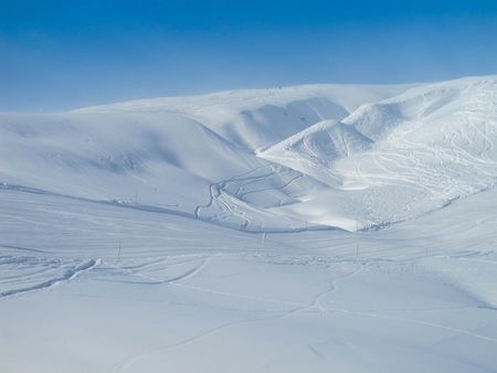 off piste: Extensive ski piste and powder snow off piste. Skiing Les Contamines, French alps Stock Photo