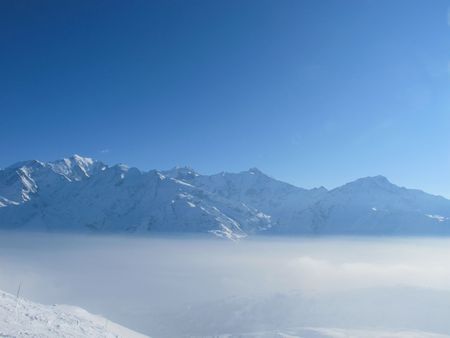 Mountain peaks above the clouds, les Contamines, French alps Stock Photo - 8031652
