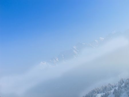 French alps seen rising above the mountain mist. les contamines. photo