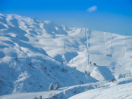 Ski slopes on bright sunny day  with fresh powder. Les Contamines, French alps photo