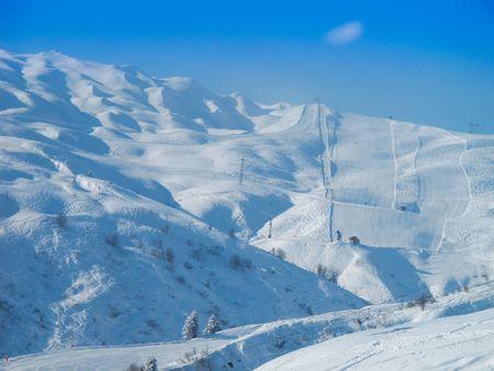 Ski slopes on bright sunny day  with fresh powder. Les Contamines, French alps Stock Photo - 8031678