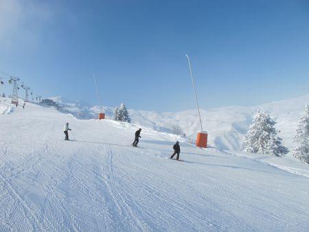 Skiers on wide ski slope on sunny day. Blue sky, Chamonix . French alps. photo
