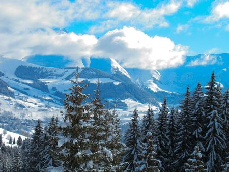 Ski area mountain landscape with Mont Blanc in distance . Combloux French alps France photo