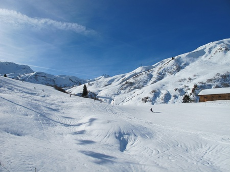 wintersport: Ski slopes on sunny day in Austrian alps