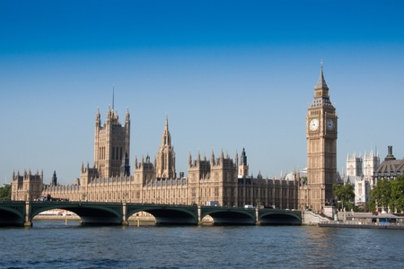 thames: Houses of parliament overlooking River Thames and Westminister bridge on bright sunny morning