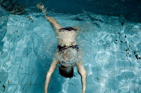 Abstract Women in the pool.Underwater. photo