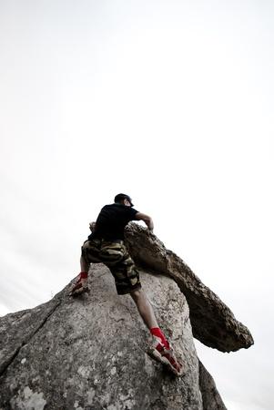 stress testing: Man in mountain,Bouldering.