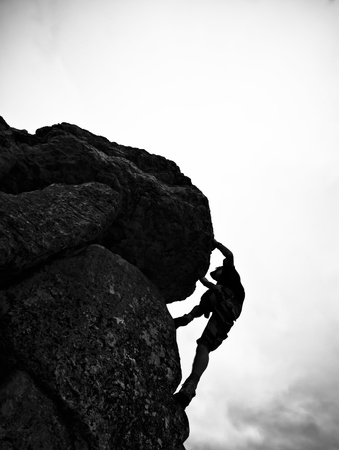 Man in action of mountain,Bouldering. photo