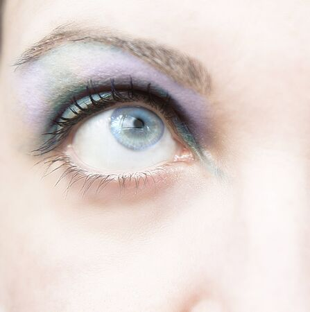 Eye of woman with blue makeup photo
