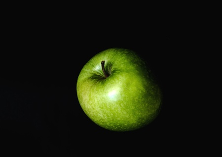 green apple isolate in black background Stock Photo