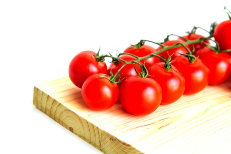 Cherry tomatoes isolated on white photo