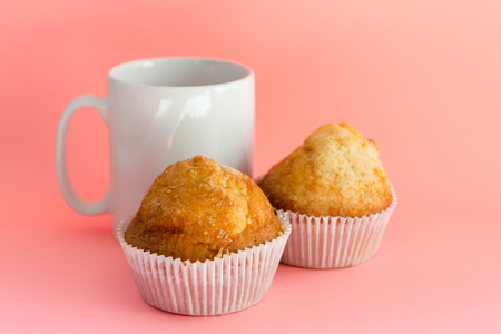Muffins and mug. Homemade pastries, sweet cupcakes for breakfast