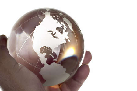 Globe made of glass in hand photo