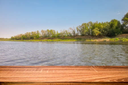 Empty wooden table with summer background of riverside in the daytime. Can be used for display or montage products Stock fotó