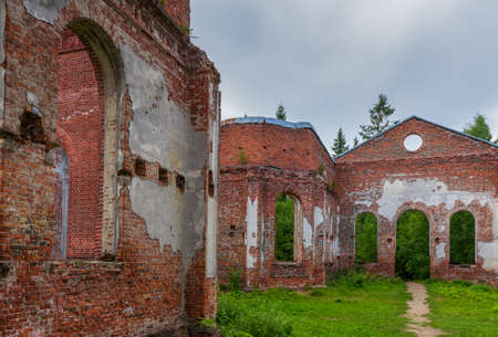 Ruined Lutheran church in Lahdenpohja, Karelia, Russia. Destroyed protestant temple in summer day. Architectural landmark in northern Russian town with Finnish heritage. Background for history theme. Stock Photo