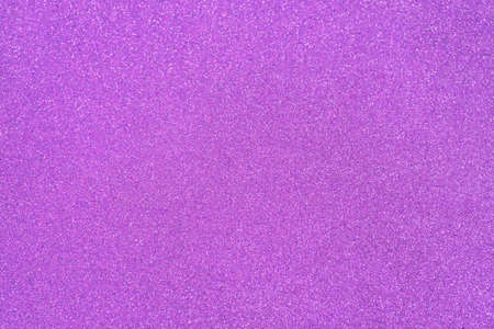 Violet orchid glitter twinkle abstract New Year or Christmas holiday background with sparkles. Modern luxury mock up with sequins. Texture of colored porous rubber with spangles.