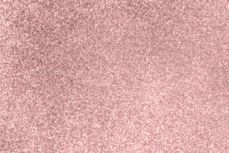 Pale pink glitter twinkle abstract New Year or Christmas holiday background with sparkles. Modern luxury mock up with sequins. Texture of colored porous rubber with spangles.
