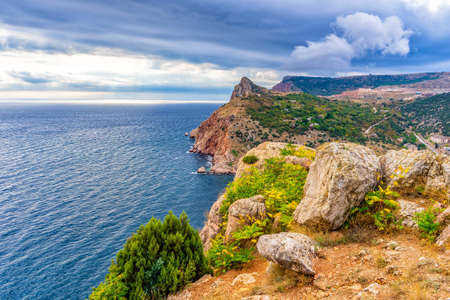 Beautiful panoramic landscape with sea coast in mountain area. Picturesque seascape with sky, water and coastline in autumn cloudy day. Black sea, Sevastopol vicinity, Crimea, Russia.