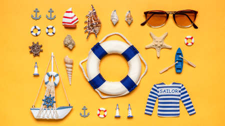 Various decorative nautical items, sailboat, life buoy and sunglasses on bright yellow background. Text WELCOME ABOARD. Sea travel, summer vacation at ocean concept. Flat lay, top view. Standard-Bild