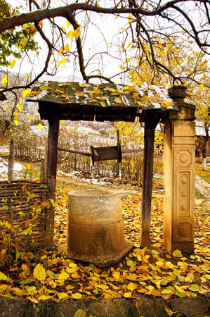 ethnographical: Old stone well - rural landscape Stock Photo