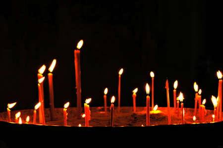Candles in ancient church photo