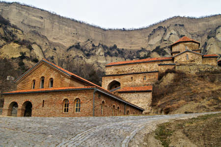 Exterior of ancient mountain monastery in Georgia - Shiogvime. It was found by one of the 12 assirian monk - Shio, who came to Georgia in 6 century AD  Stock Photo