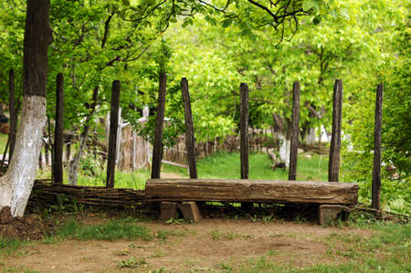 garden bench in rural landscape photo