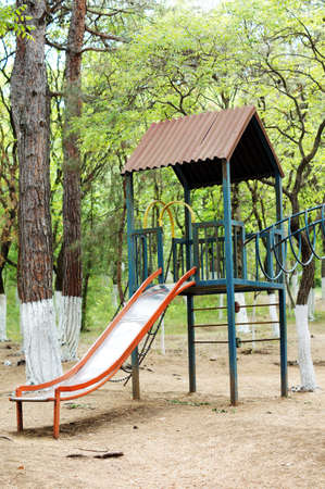 Colorful children playground in the city park without children photo