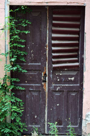 ethnographical: old wooden door in antique house Stock Photo